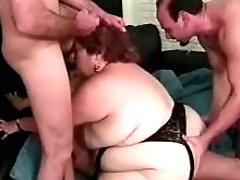 Horny BBW drinks fresh cum in orgy