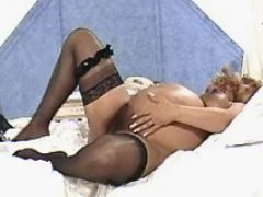 Pregnant babe masturbates in bedroom