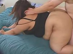 Enormous ebony woman fucking on bed