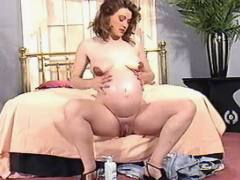 Cute pregnant babe shows big belly