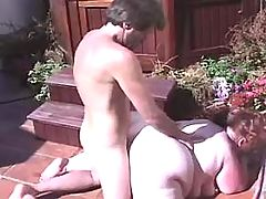Busty greasy brunette in fuck orgy with dudes