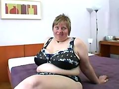 Chubby mature seduces man in bedroom